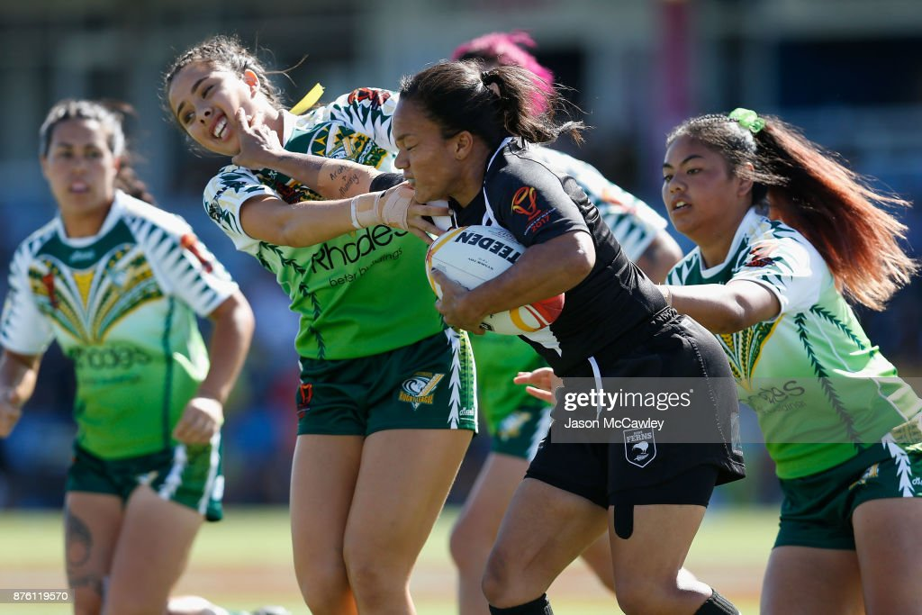 Shontelle Woodman of New Zealand puts on a fend uring the 2017 Women's Rugby League World Cup match between New Zealand and Cook Islands at Southern Cross Group Stadium on November 19, 2017 in Sydney, Australia.