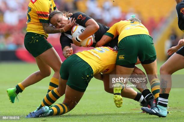 Shontelle Woodman of the Ferns is tackled during the 2017 Rugby League Women's World Cup Final between Australia and New Zealand at Suncorp Stadium...