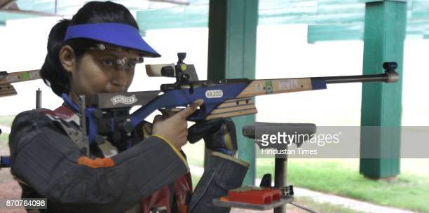 Shooter Anjali Bhagwat take part in the 50meter Air rifle woman shooting event in the ongoing 34th National Games at Mega sports Complex Hotwar in...