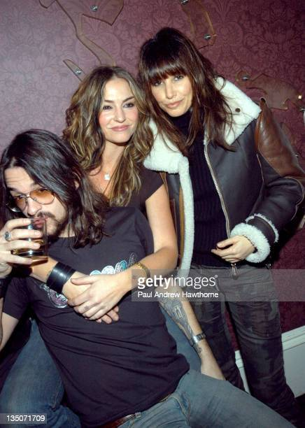 Shooter Drea de Matteo and Gina Gershon during Paper Magazine and Svedka Vodka Celebrate Paper Magazine's February Issue Featuring Pharrell Williams...