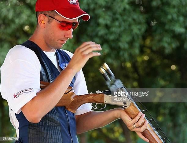 US shooter Joshua Richmond discharges his spent cartridges during the double trap final competition of the first day of the ISSF World Shooting...