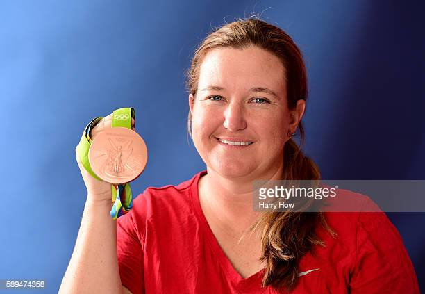 Shooter Kim Rhode of the United States poses for a photo with her bronze medal on the Today show set on Copacabana Beach on August 13 2016 in Rio de...