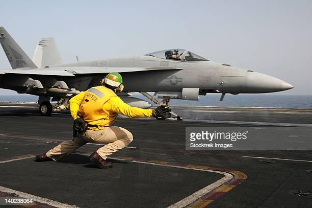 A shooter launches an F/A-18E Super Hornet from USS Dwight D Eisenhower.