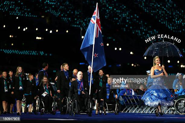 Shooter Michael Johnson of New Zealand carries the flag during the Opening Ceremony of the London 2012 Paralympics at the Olympic Stadium on August...