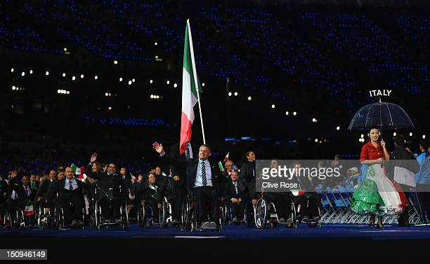 Shooter Oscar De Pellegrin of Italy carries the flag during the Opening Ceremony of the London 2012 Paralympics at the Olympic Stadium on August 29...