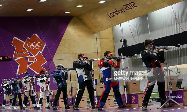 Shooters compete in the in the men's 10m air rifle final during the London 2012 Olympic Games at the Royal Artillery Barracks in London July 30 2012...