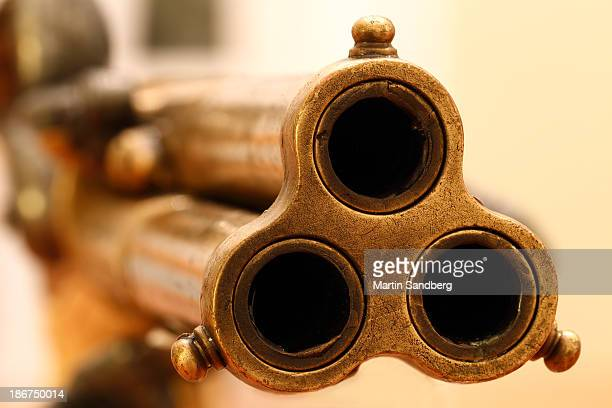 shooting a round - gun barrel stock pictures, royalty-free photos & images