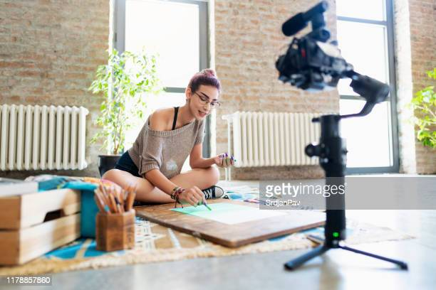 shooting art videos for her vlog - camera photographic equipment stock pictures, royalty-free photos & images