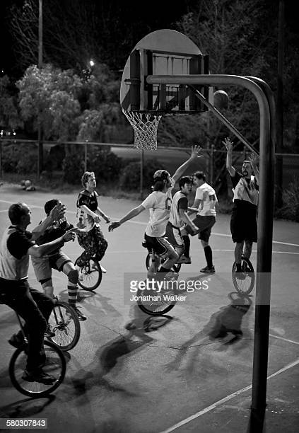 Shooting from the Rim. Why I love Berkeley. A bunch of UC Berkeley science dudes with unicycles playing a bit of night ball on a local city park...