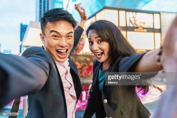 shooting funny selfies business couple in kuala lumpur - downtown comedy duo stock pictures, royalty-free photos & images