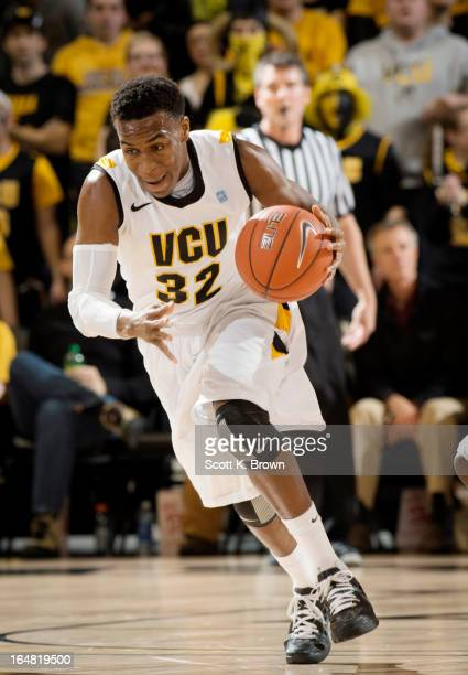 Shooting guard Melvin Johnson of the VCU Rams drives the ball down the court during the game against the Saint Joseph's Hawks at the Siegel Center on...