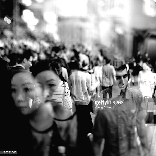 Shooting into a crowded street with the double exposure feature of the Nikon D800E. There are so many tools in the camera to play with. Hong Kong,...