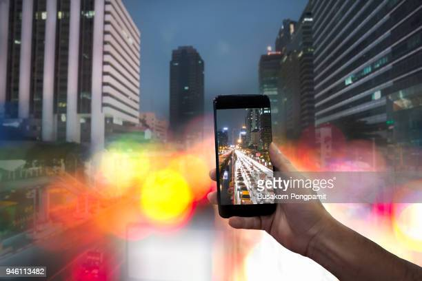 shooting light on road in the city at night with mobile phone - fast shutter speed stock photos and pictures