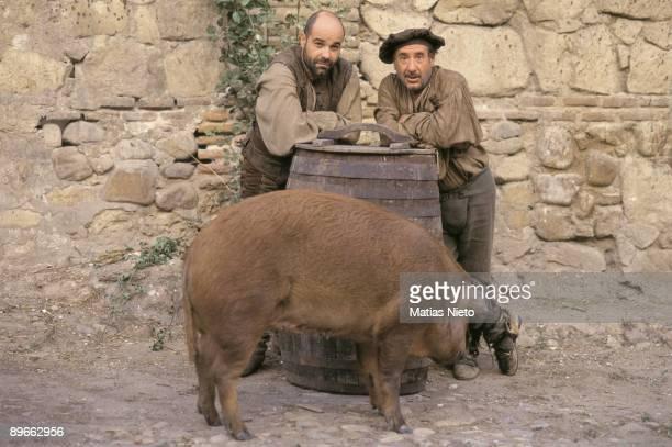 Shooting of ´La Marrana´ by Jose Luis Cuerda The actors Antonio Resines and Alfredo Landa with a pig