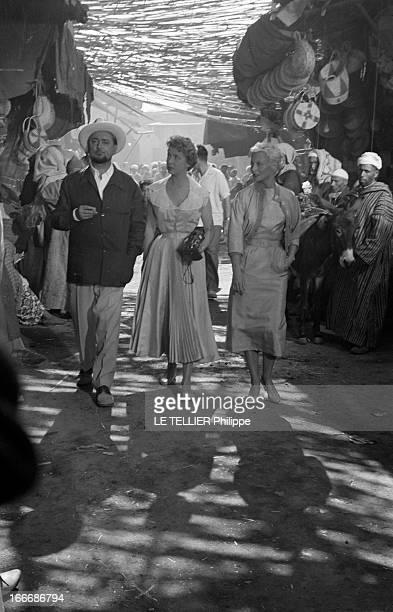 Shooting Of The Film 'Oasis' By Yves Allegret In Morocco. Au Maroc, sur le tournage du film 'Oasis' d'Yves ALLEGRET, dans l'allée d'un souk, Pierre...