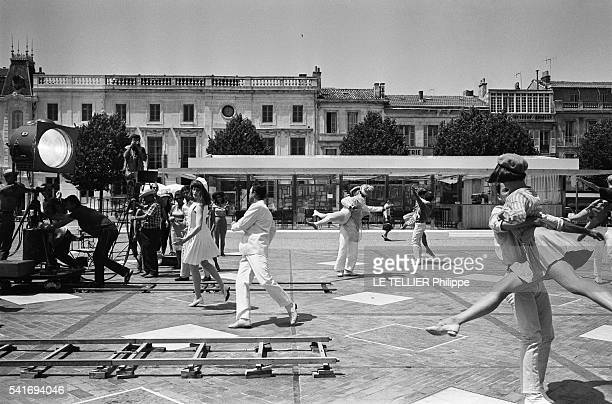 shooting of the movie Les Demoiselles de Rochefort by Jacques Demy the actress Francoise Dorleac and the dancer Gene Kelly on the place Colbert in...