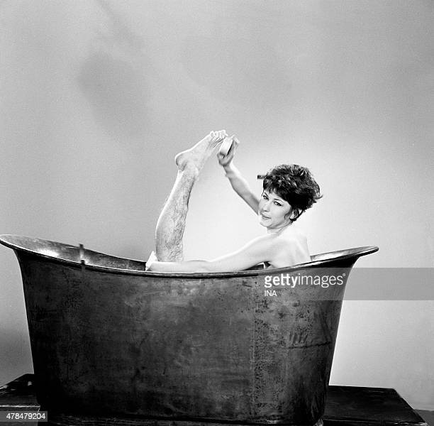 Shooting of the program The green grapes in her bathtub a woman soaps her hairy leg