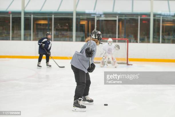 shooting on net - fat goalkeeper stock pictures, royalty-free photos & images
