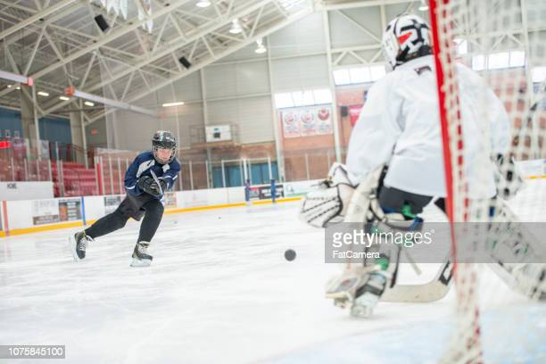 shooting on the neck - fat goalkeeper stock pictures, royalty-free photos & images