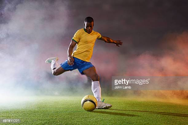 shooting power - football player stock pictures, royalty-free photos & images