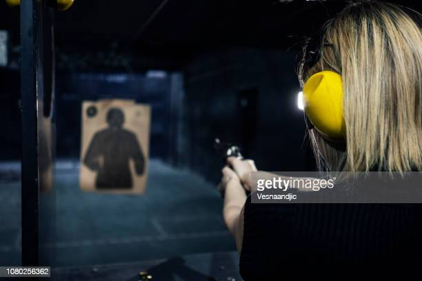 shooting range - shooting a weapon stock pictures, royalty-free photos & images