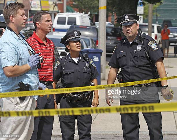 Shooting scene on Columbia Road Dorchester Boston Police detectives and Boston Police officers look over a crime scene