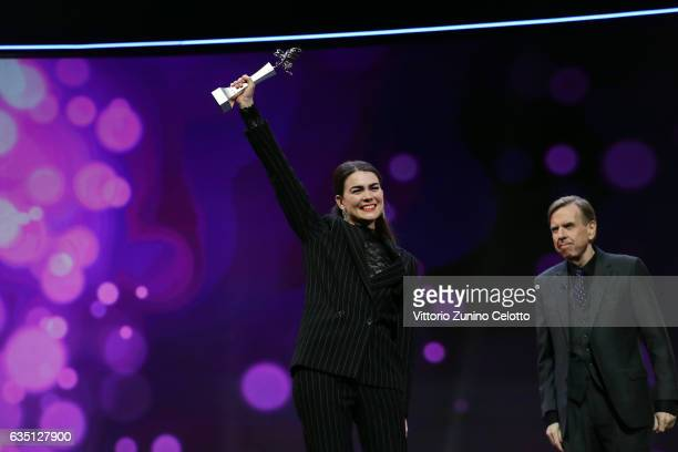 Shooting Star Karin Franz Koerlof receives the award from actor Timothy Spall at the 'The Party' premiere during the 67th Berlinale International...