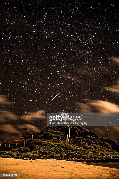 Shooting Star Meteor Flying Across the Night Sky Over Pyramid Rock Lighthouse at a Beach in Kailua Oahu Hawaii
