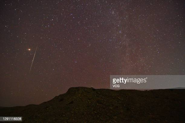 Shooting star of the Geminid meteor shower is pictured at Hejing County on December 13, 2020 in Bayingolin Mongol Autonomous Prefecture, Xinjiang...