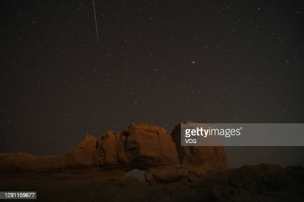 Shooting star of the Geminid meteor shower is pictured at Yuli County on December 14, 2020 in Bayingolin Mongol Autonomous Prefecture, Xinjiang...