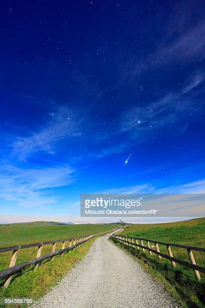 Shooting star over single track road