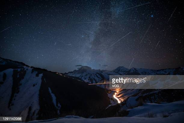 Shooting stars of the Geminid meteor shower are pictured on December 12, 2020 in Ili Kazakh Autonomous Prefecture, Xinjiang Uygur Autonomous Region...