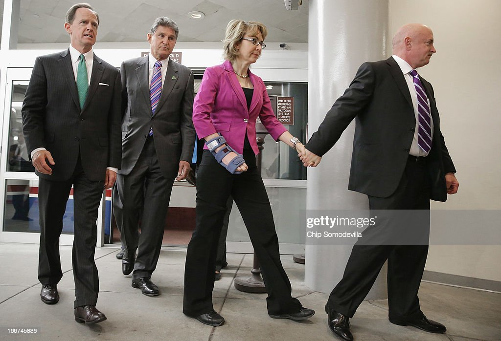 Shooting victim and former Rep. Gabrielle Giffords (D-AZ) (2nd R) and her husband and retired astronaut Mark Kelly (R) join Sen. Joe Manchin (D-WV) (L) and Sen. Pat Toomey (R-PA) at the U.S. Capitol April 16, 2013 in Washington, DC. Giffords and Kelly met with members of Congress, including Manchin and Toomey, who have sponsored legislation to expand the background check system for gun sales.
