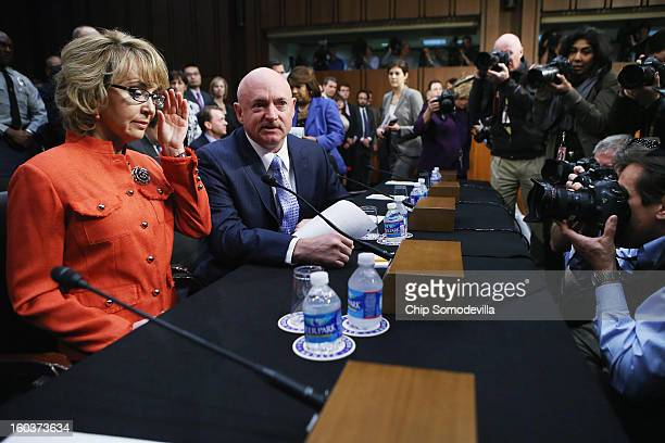 Shooting victim and former US Rep Gabby Giffords and her husband Retired NASA astronaut and Navy Capt Mark Kelly arrive for a Senate Judiciary...