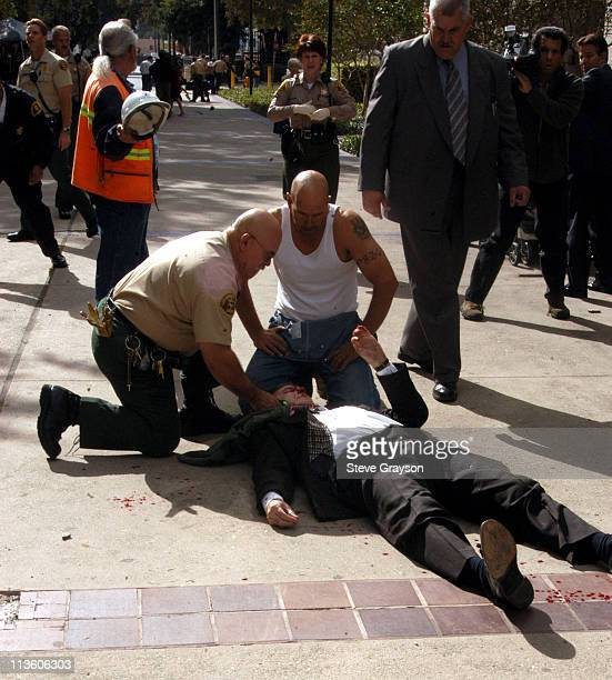 Shooting Victim Gerald E Curry is attended by Police personel outside the Los Angeles Superior Courthouse in Van Nuys California October 31 2003 The...