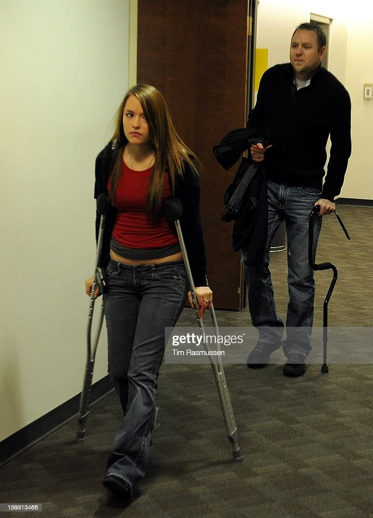 Shooting victim Joshua Nowlan ¨ and another victim enter the second floor of the Arapahoe County Courthouse, Friday, January 11, 2013 on their way to the courtroom. The arraignment for Aurora theater shooting suspect James Holmes was postponed until March 2013 for the July 20 shooting at the Century 16 theater that killed 12 people and injured 70 others.
