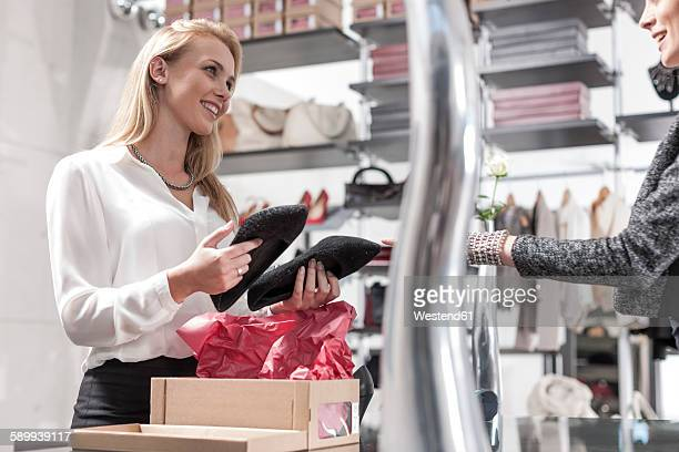 Shop assistant and customer in a shoe shop