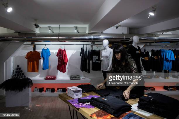 A shop assistant folds some clothes at the 'Pornhub Christmas Store' on December 1 2017 in Milan Italy Pornhub the largest pornography site on the...