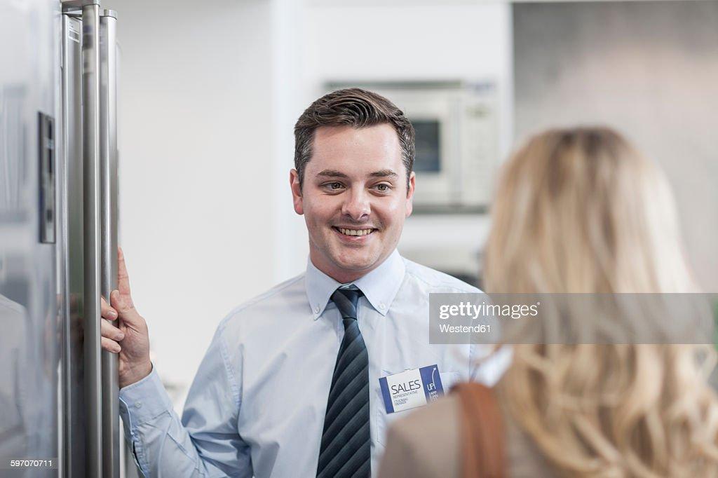 Shop assistant smiling at customer : Foto de stock