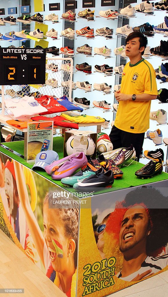 A shop assistant stands next to World Cup 2010 accessories while waiting for customers in Hong Kong on June 5, 2010. The World Cup football 2010 starts on June 11.