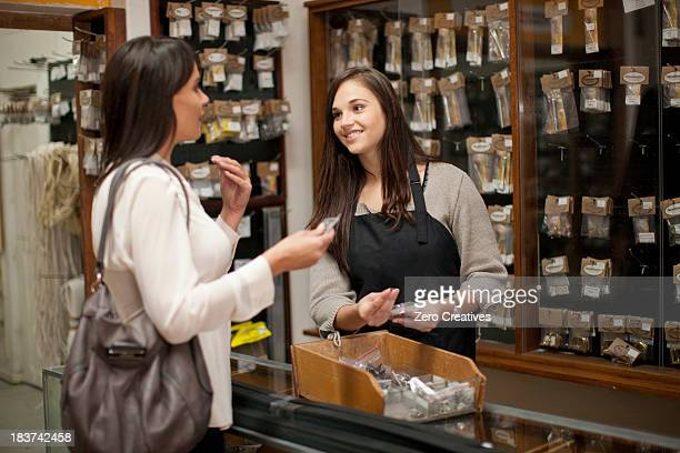 Shop assistant talking to customer in hardware store