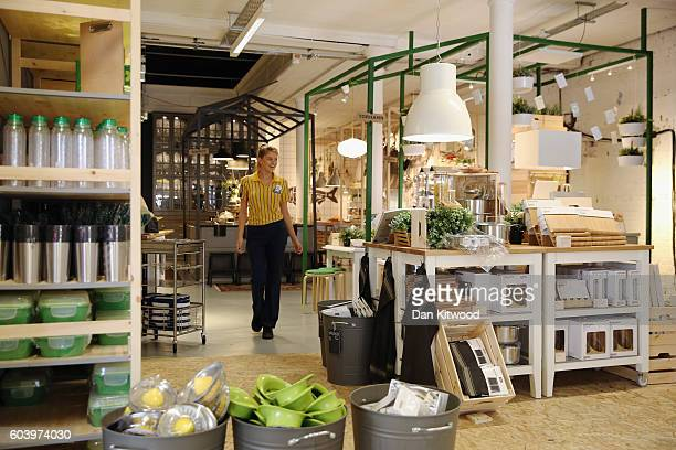 A shop assistant walks through Ikea's 'The Dining Club' pop up restaurant cafe and shop in Shoreditch on September 13 2016 in London England The...