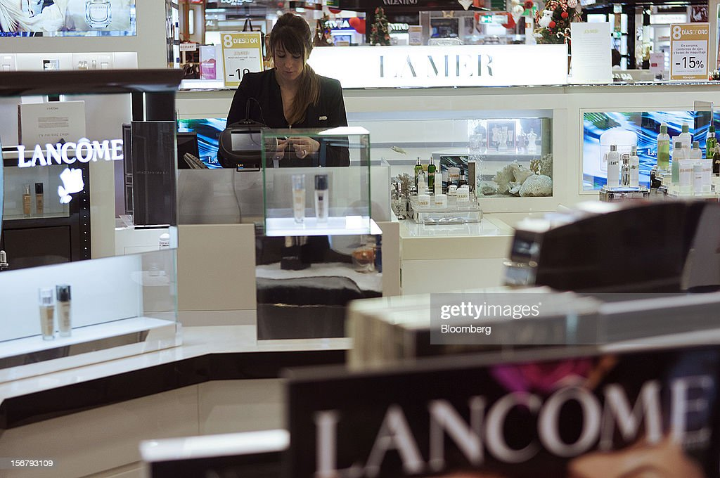 A shop assistant works at a counter near Lancome signs in the beauty department at the El Corte Ingles department store at Plaza Cataluna in Barcelona, Spain, on Wednesday, Nov. 21, 2012. Bank of Spain Governor Luis Maria Linde said the government risks missing its budget targets this year and next, adding to doubts on Prime Minister Mariano Rajoy's ability to cut the deficit amid a five-year slump. Photographer: Stefano Buonamici/Bloomberg via Getty Images