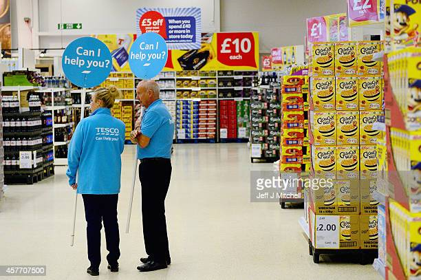 Shop assistants are seen at a Tesco supermarket on October 23 2014 in Glasgow ScotlandTesco one of Britains biggest supermarkets has announced a 919%...