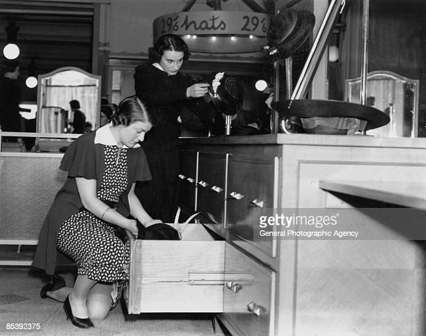 Shop assistants in the millinery department at Selfridges department store on Oxford Street London circa 1935