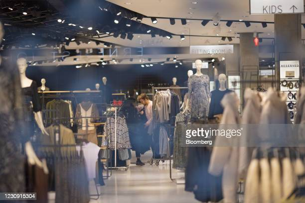Shop assistants work inside a closed Zara clothing store on Oxford Street in central London, U.K., on Monday, Feb. 1, 2021. At least one-fifth of...