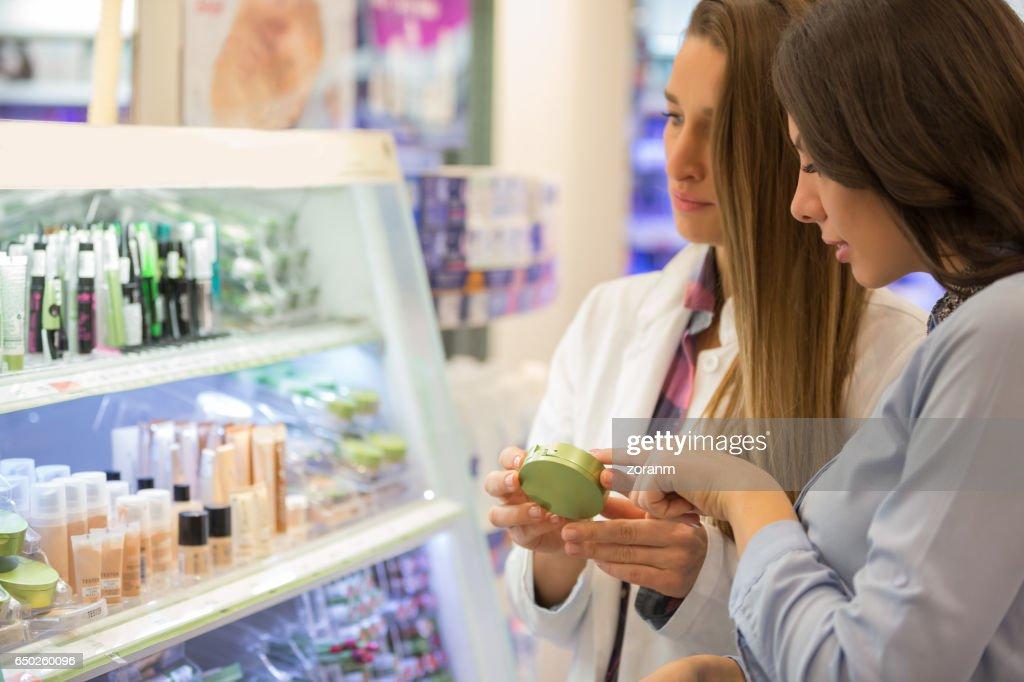 Shop assitant advising customer : Stock Photo