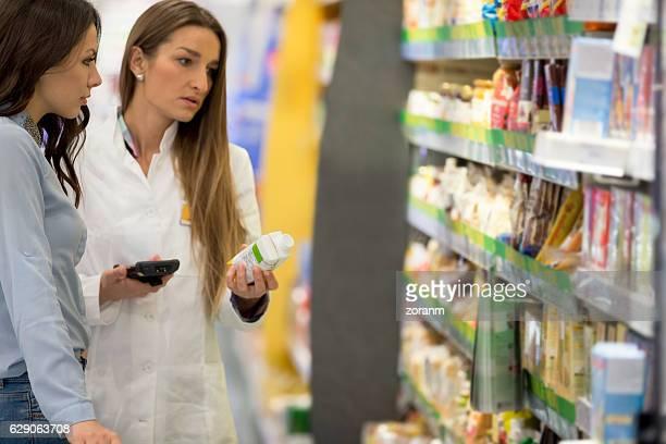 Shop assitant helping customer