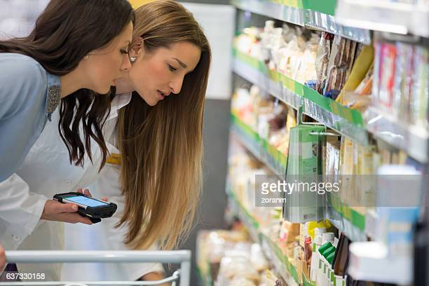 Shop assitant with customer