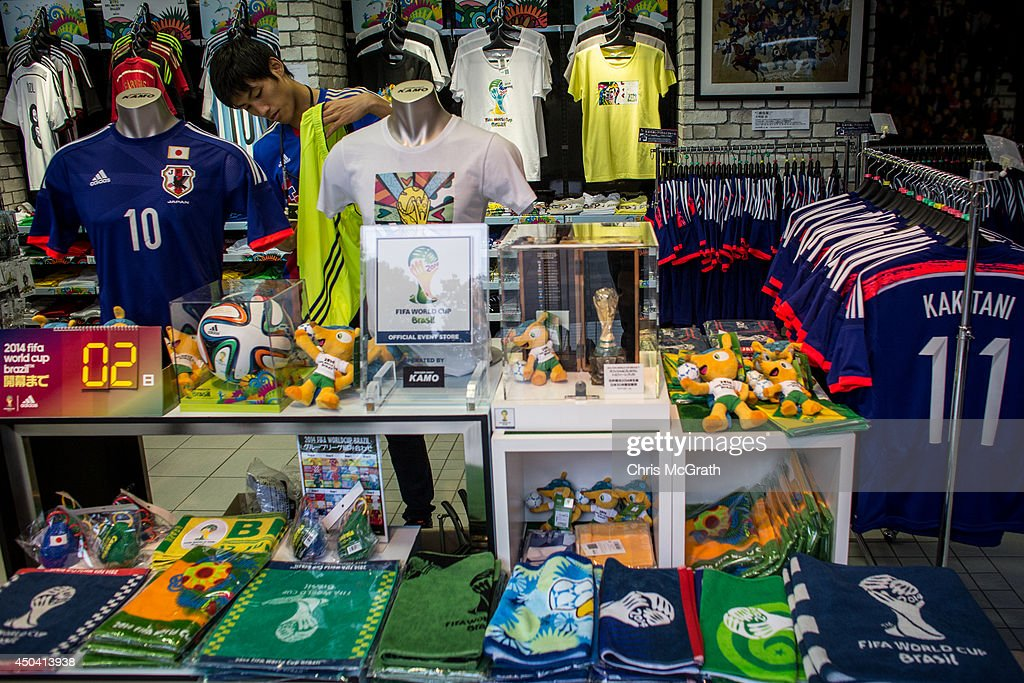 A shop attendant works amongst Japan World Cup team merchandise and FIFA World Cup 2014 merchandise at a football store on June 11, 2014 in Tokyo, Japan. The World Cup 2014 in Brazil will begin on June 12th with the first match between Brazil and Croatia.